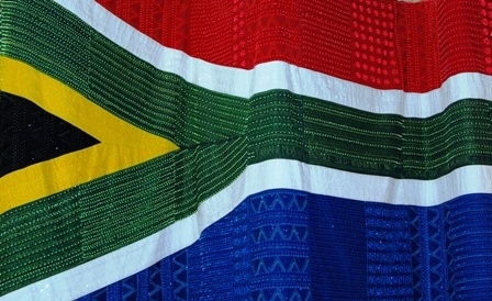 Hand beaded, embroidered SA flag hangs in the Constitutional Court. Source: www.commons.wikimedia.org