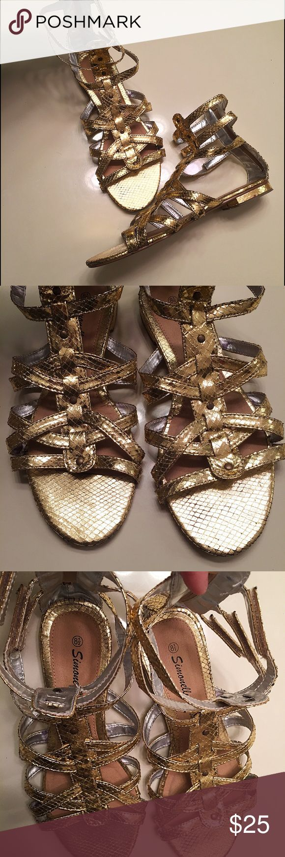 Shiny gold gladiator sandals snakeskin zip up Shiny snakeskin gold gladiator sandals women's size 8.5 by Simonelli. Have been worn a few times but are in good condition. Adorable style but too big for me. Zippers in the back for convenience Shoes Sandals
