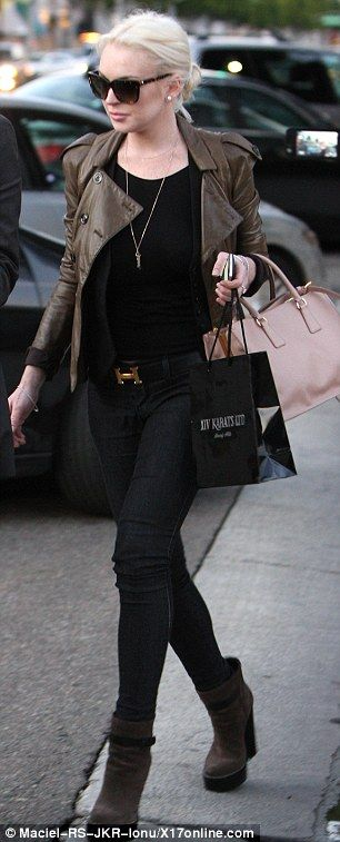 Regardless of the fact that I loathe Lindsay Lohan, AND the fact that she decided to go out in this sheer black top sans bra (thankfully hard to tell here), I do like this outfit.