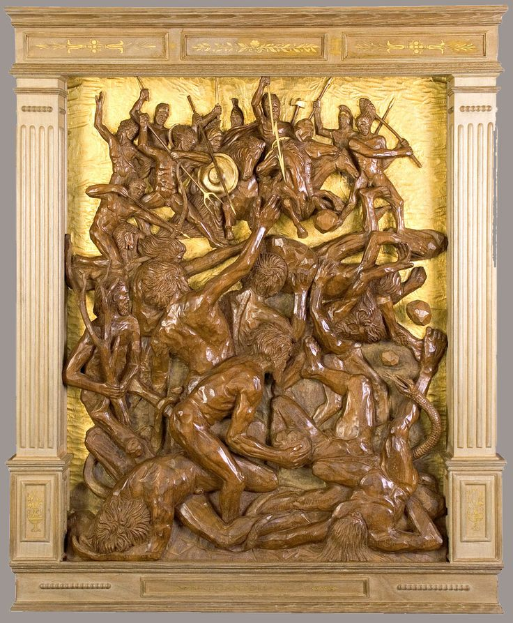 "J. M. Félix Magdalena.- ""GIGANTOMAQUIA"", relieve tallado en madera de iroko,  132 x 108 x 11 cm."