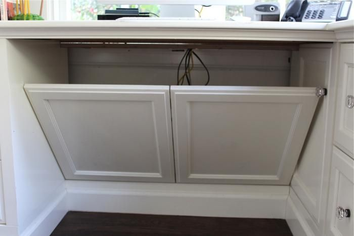 banish computer cords ~ 5 ingenious ways ~ ex. false panel behind desk to hide cords via Gardenista ~ love this!