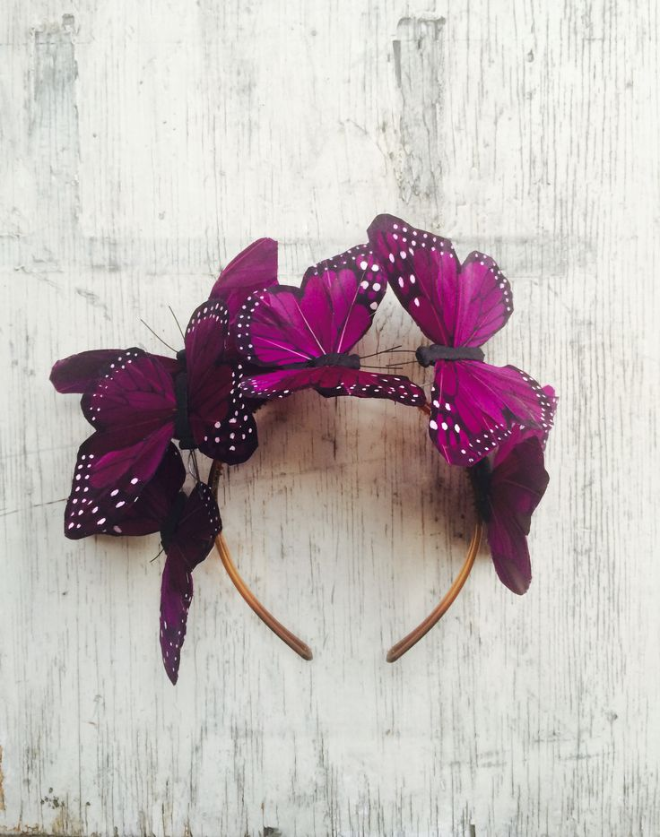 Teeming with whimsy, feather butterflies hover delicately above your head  in a vibrant purple palette. A gorgeous detail to add to your accessories  wardrobe, this headpiece can transform your entire look. Turn any event  into a regal affair with this decadent yet incredibly wearable piece that  will ensure all eyes are on you.  Excellent for long or short hair, and perfect for fashion conscious brides  and bohemian socialites.      * Hand painted butterflies made of real feathers…