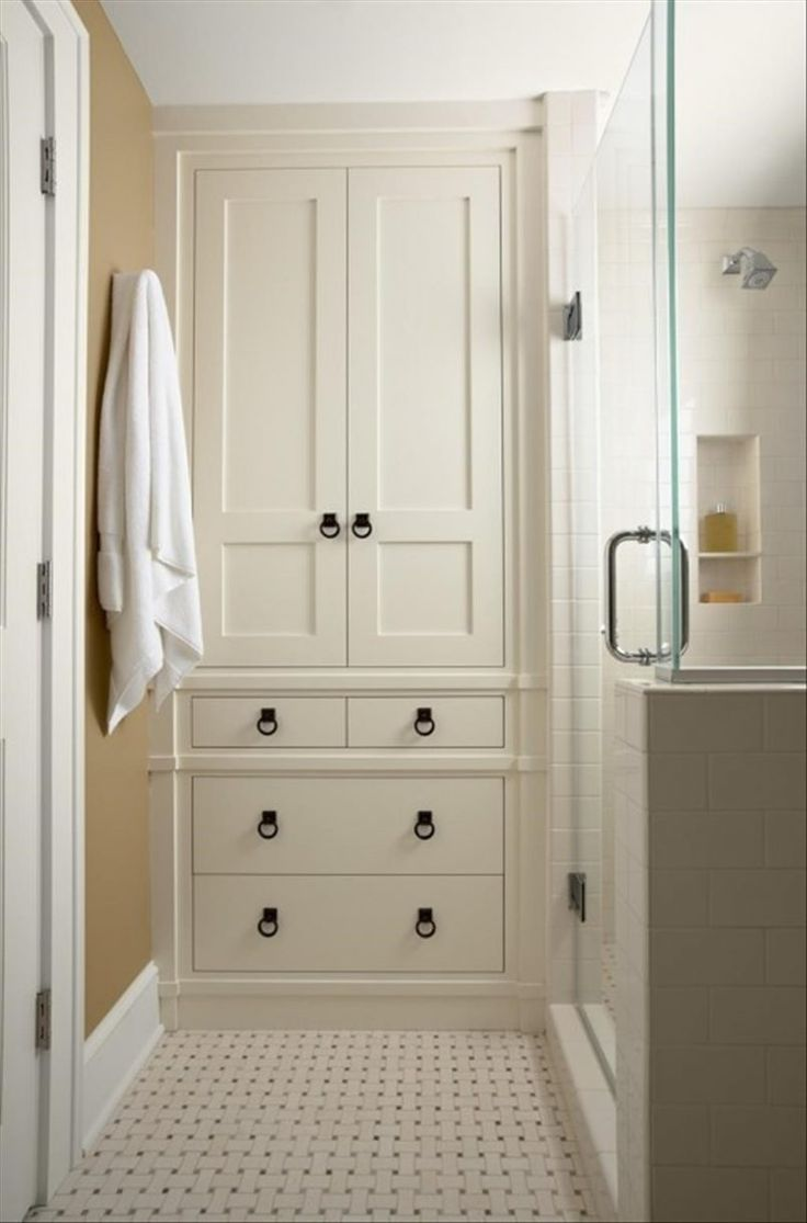 Bathroom Cream Classic Stained Wooden Closet Storage With White Towel Point Pattern Floor Also Glass Door And  Design Moves from Tricked-Out Bathroom