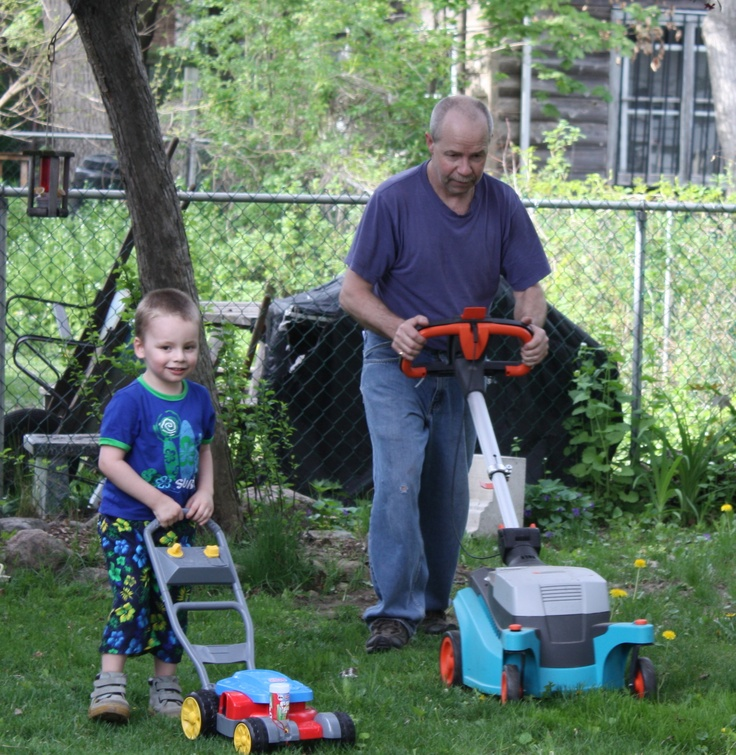 Poppa and William cutting the grass