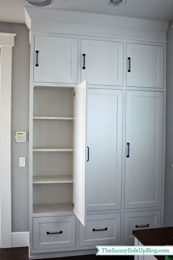 Love these locker units with adjustable shelves, small cabinets above them, and drawers below. Maybe make one cabinet without shelves and instead with a rail for hanging coats (a shelf right at the bottom for shoes to sit under coats).