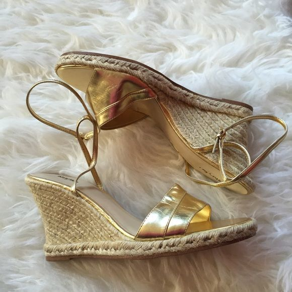 Mossimo Gold Wedge Sandal Cute gold wedge sandals! Easy way to dress up any outfit. See last photo for damage, some scuffing on the edge. Really small, and can be covered with a gold sharpie! Mossimo Shoes Wedges