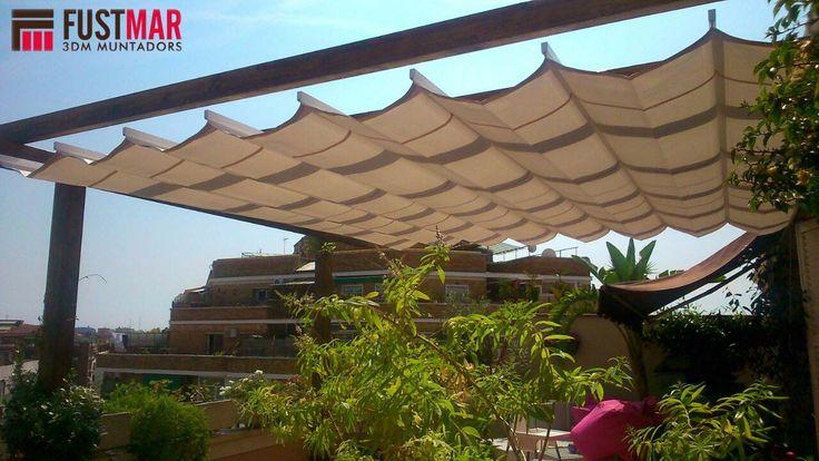 Pergola de madera de abeto laminado lasurado en color nogal.  Acabada con toldo corredero acrilico. www.fustmar.com