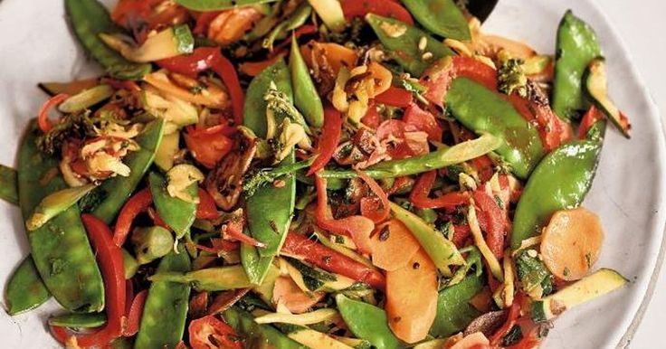 This recipe for Indian Five-Spice Vegetable Stir Fry, cooked by Nadiya Hussain in her Nadiya's British Food Adventure BBC series, is a perfect vegetarian family meal.