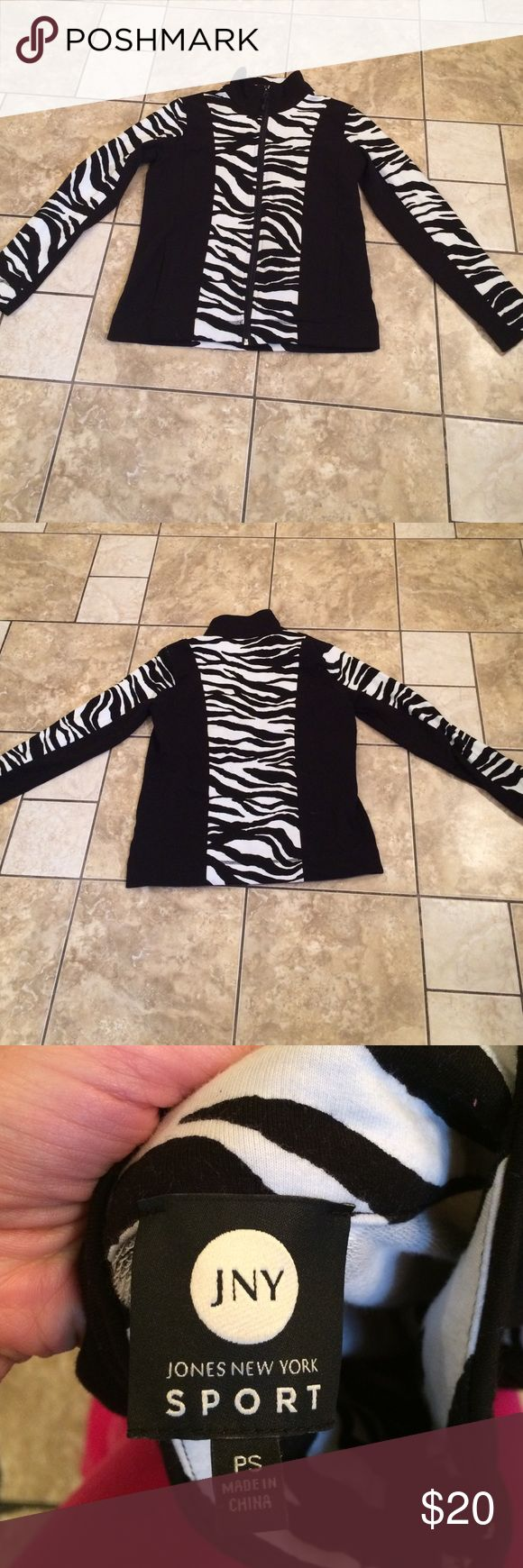 Zip up Jones NY sport sweater This is a zebra print zip up light sweater. I love it paired with leggings for those lazy Sunday afternoons or out running errands Jones New York Sweaters