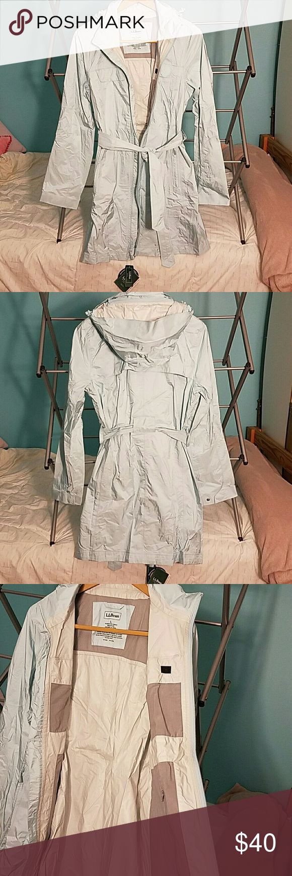 L.L.Bean light blue Rain Jacket West end trench coat. Sinches at waist for a flattering fit but will keep you dry in even the heaviest rain.  Lightweight, Waterproof, Breathable TEK 2.5 waterproof system. Has a removable hood and adjustable cuffs. Longer length offers plenty of coverage. Has 4 pockets on the outside and one inside pocket. L.L. Bean Jackets & Coats Trench Coats
