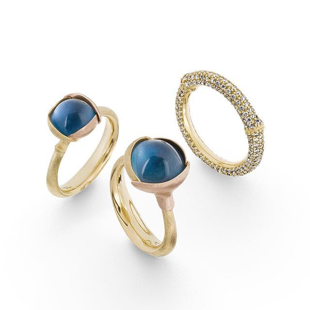 A Nature ring filled with diamonds together with two Lotus rings in topaz / Ole Lynggaard Copenhagen / Charlotte Lynggaard