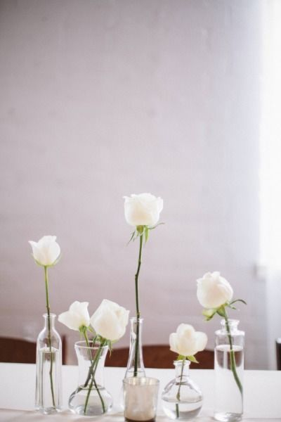 Pretty white flowers in small vases: http://www.stylemepretty.com/2014/06/25/all-white-modern-hollywood-wedding/ | Photography: Taylor Made Art - http://taylormadeart.com/
