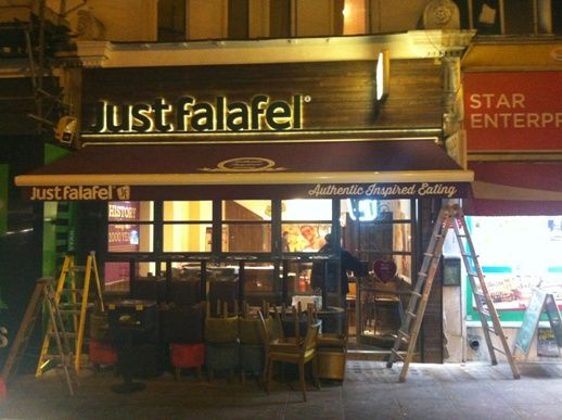 New Just Falafel at Fulham Broadway, London.  Awning supplied & installed by Shades of Comfort