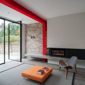 Tigg+Coll+Architects+integrates+bright-red+steel+frame+in+London+house+extension