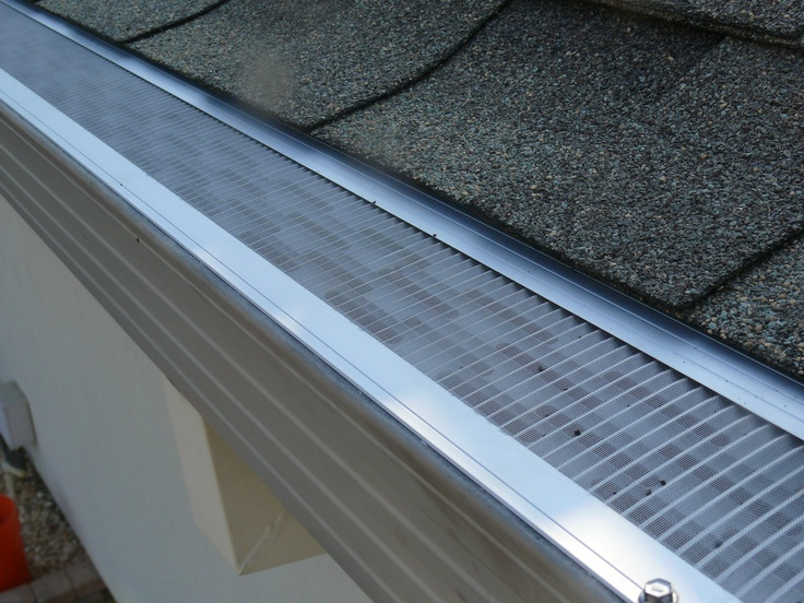 Gutterglove Ultra consists of two components, a perforated aluminum channel and type 316 stainless steel mesh. The stainless steel mesh is glued into grooves along both sides of each 5 foot aluminum channel section. It installs on any existing gutter. Gutterglove's specifications were designed so that it simply slips under the roof shingles and fits snuggly to the front lip of your gutter.