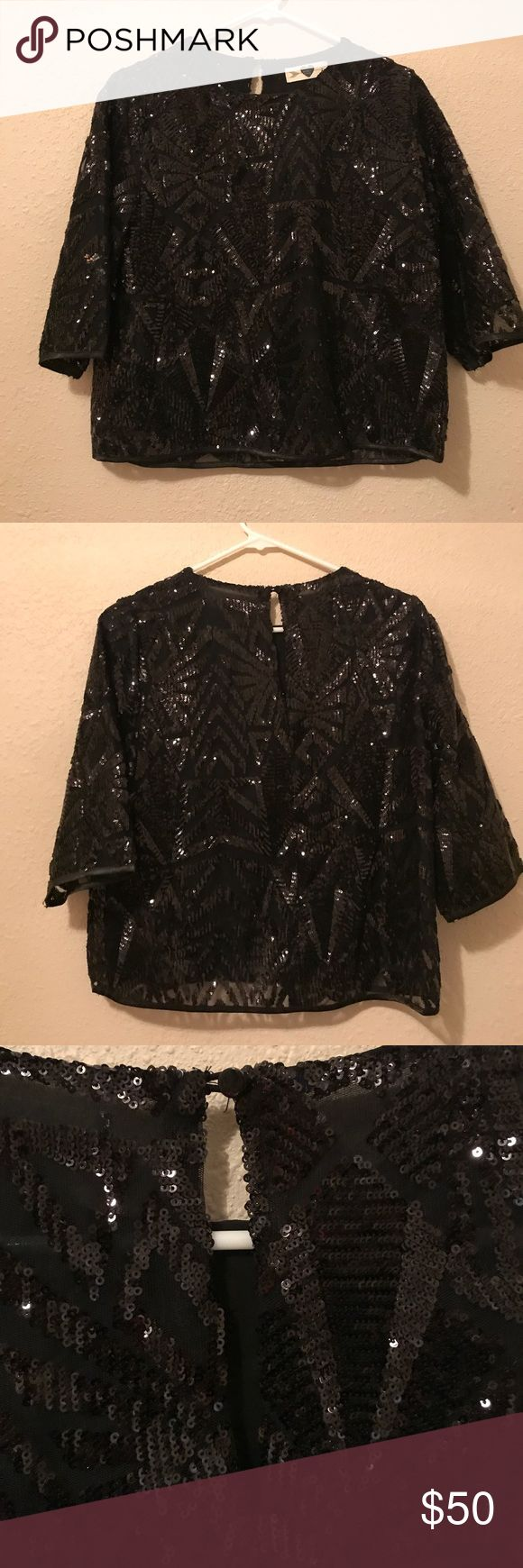Sparkle blouse I love this top! Only worn once (last New Years) and is in perfect condition. No missing beads. Brand is honey love and I purchased it from a local boutique. Accepting all reasonable offers but no trades. honey love Tops
