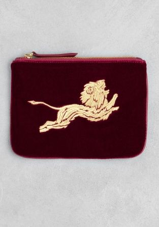 &OTHER STORIES Crafted from soft velvet, with an embroidered lion on the…