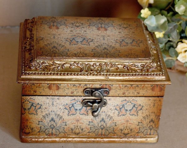 wooden jewelry box with ancient clock inside
