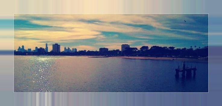 St. Kilda Beach, Melbourne Australia. Facing the city scape off St. Kilda Pier..(retro effect added).