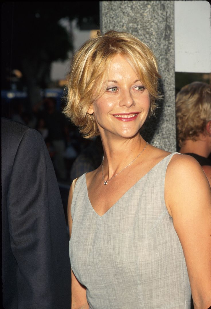 """While """"The Rachel"""" may be the number one haircut we think of when it comes to the '90s, Meg Ryan's classic feathered style is a close second.  - GoodHousekeeping.com"""