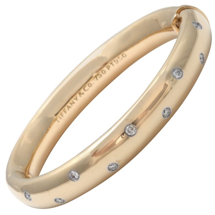 TIFFANY and Co. Gold And Diamond Bangle Bracelet