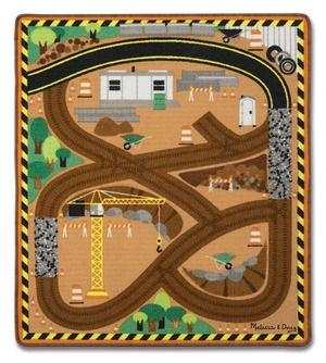 Round the Construction Zone Work Site Rug & Vehicle Set: Get to work all around the construction zone with this sturdy, colorful construction site rug! Durably made to look great for countless playtimes to come, the woven rug with a skid-proof backing comes with three wooden construction vehicles and features details like a crane, wheelbarrows, barriers, cones, and roads to accommodate all kinds of vehicles, play people, and more! With this rug, there are lots of ways to learn and play.