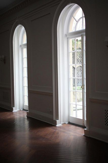 Arched transoms, French doors, trim, herringbone pattern floor, love the architecture details and natural light... IMG_3056 by Sarah Ryhanen, via Flickr