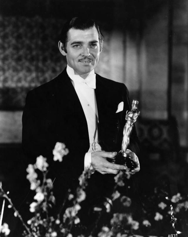 """Clark Gable receiving the Best Actor Award for his role in the film """"It Happened One Night"""" at the 7th Annual Academy awards held at the Bil..."""