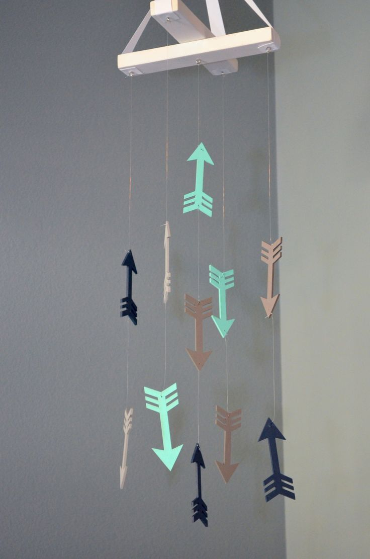 This arrow nursery mobile is the perfect piece of nursery decor for a your little boy or girl's nursery room. It works for both boys and girls as a gender neutral piece and will go with your tribal or