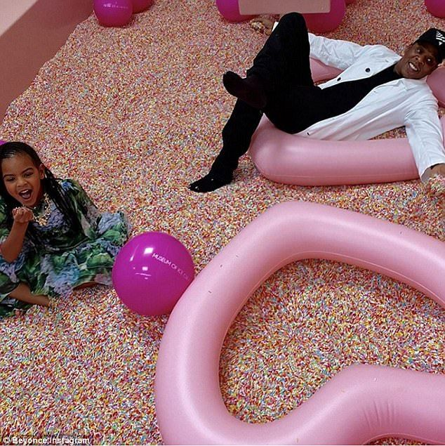 Fun for the whole family: The firstalbum she posted included a photo of Jay-Z lounging on the floor in a pink heart-shaped balloon as Blue Ivy sat near him, laughing