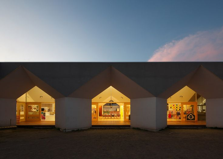 Japanese nursery features house-shaped windows and faceted ceilings