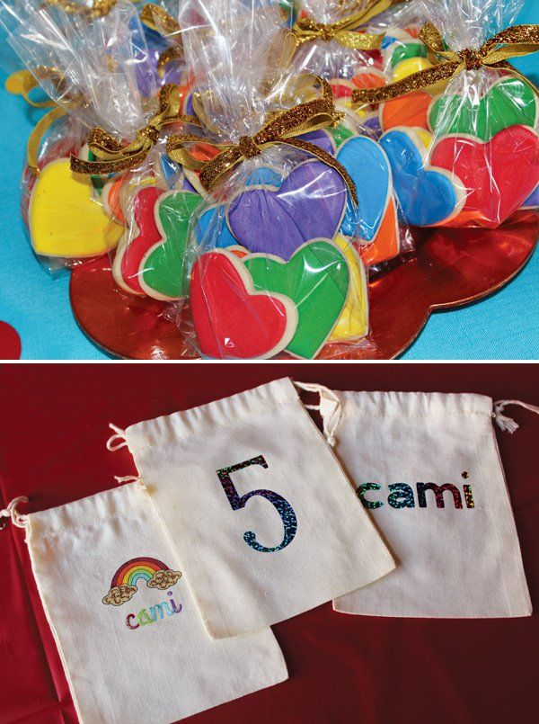 A Rainbow Dash My Little Pony Birthday Party with rainbow cookies, rainbow wands, Rainbow Dash makeovers + DIY hanging clouds with rainbow rain drops