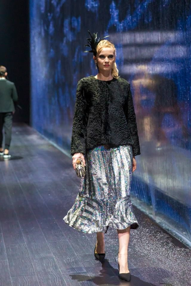 Acne (sweater), Dries Van Noten (skirt), Giuseppe Zanotti (shoes) and H.Stern (earrings) at Harvey Nichols - Dubai