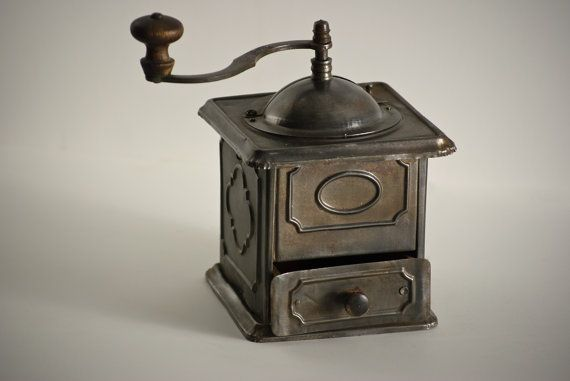 Early 1900s coffee grinder.  My granny had one of these.  Oh, how I loved to use it when I was little.