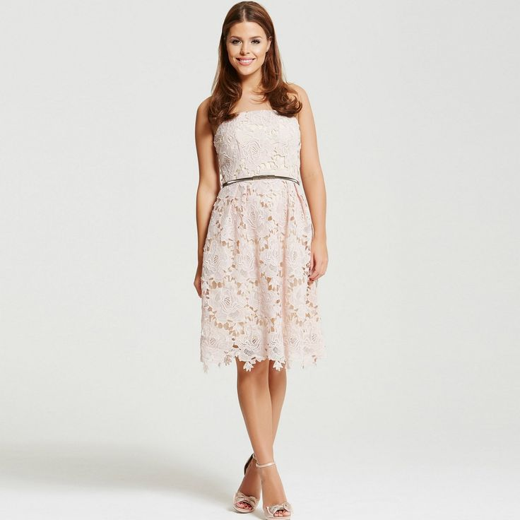 A crochet prom dress in blush with crochet hem and belted waist.
