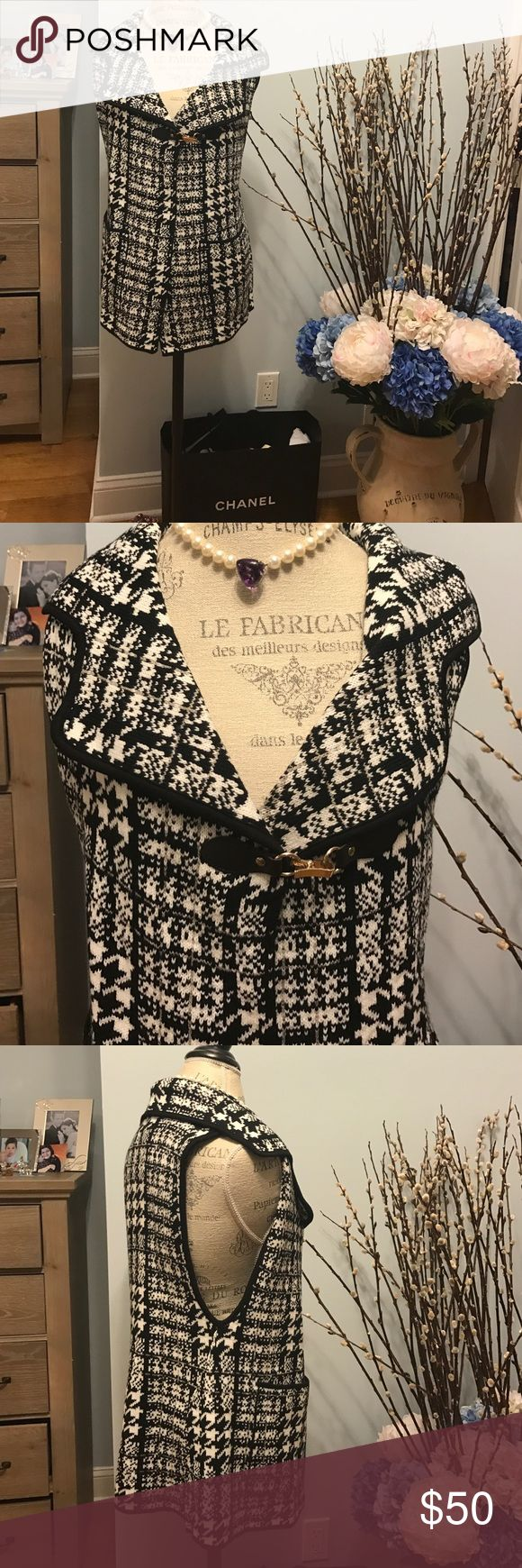 BLACK AND WHITE SWEATER VEST Stunning color block vest. Front pockets. Cute top buckle. Size S/M❤️BRAND NEW sioni Jackets & Coats Vests