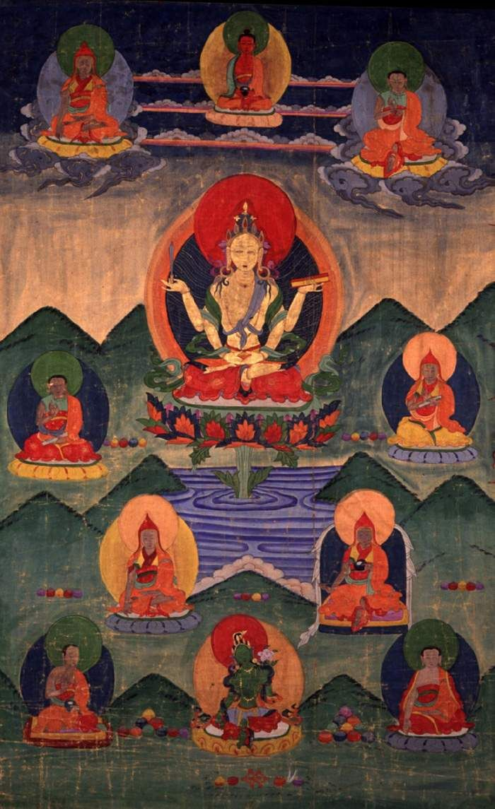 Prajnaparamita holding a book in her left hand and supporting a sword on her right hand. The books emphasizes that she is the personification of the Perfection of Wisdom literature. The sword is an emblem which she shares with Manjusri, the Bodhisattva of Wisdom. Vessantara notes that they represent two approaches to the goal of wisdom ~ it is therefore not surprising that they share this symbol.