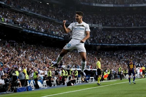 Marco Asensio Photos Photos - Marco Asensio of Real Madrid CF celebrates scoring their opening goal during the Supercopa de Espana Final 2nd Leg match between Real Madrid and FC Barcelona at Estadio Santiago Bernabeu on August 16, 2017 in Madrid, Spain. - Real Madrid v FC Barcelona - Supercopa de Espana: 2nd Leg