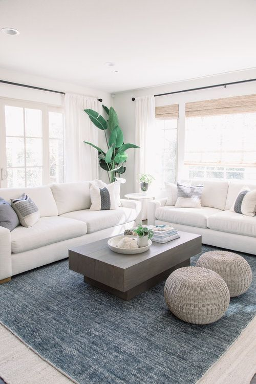 modern living room decor with modern coffee table decor, modern coffee table styling and poufs, fiddle fig, modern gray sofa with modern pillows in neutral family room design