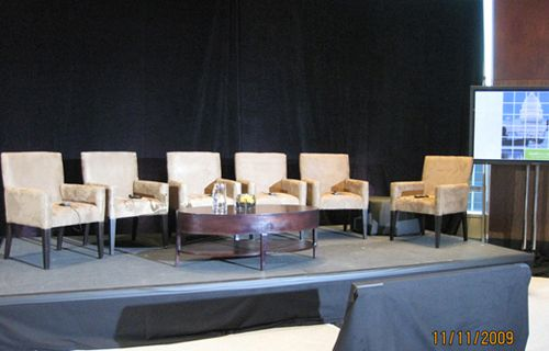 Nice clean living room style setup for a panel discussion