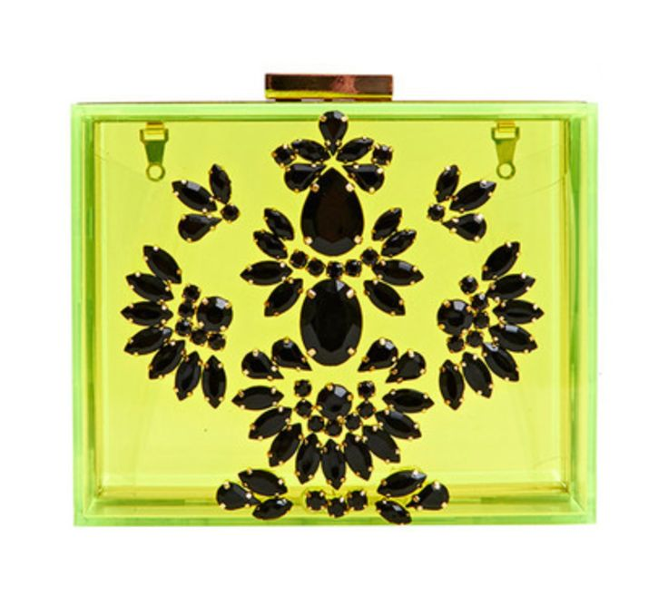 Jungle clutch bag. Made from neon yellow perspex, this box clutch is perfect for your not so secret essentials. With a black stone design and gold chain detachable strap its the perfect bag for those electric nights!  Material: Acrylic Base Dimensions: L: 15cm H: 12.5cm D: 7cm £50