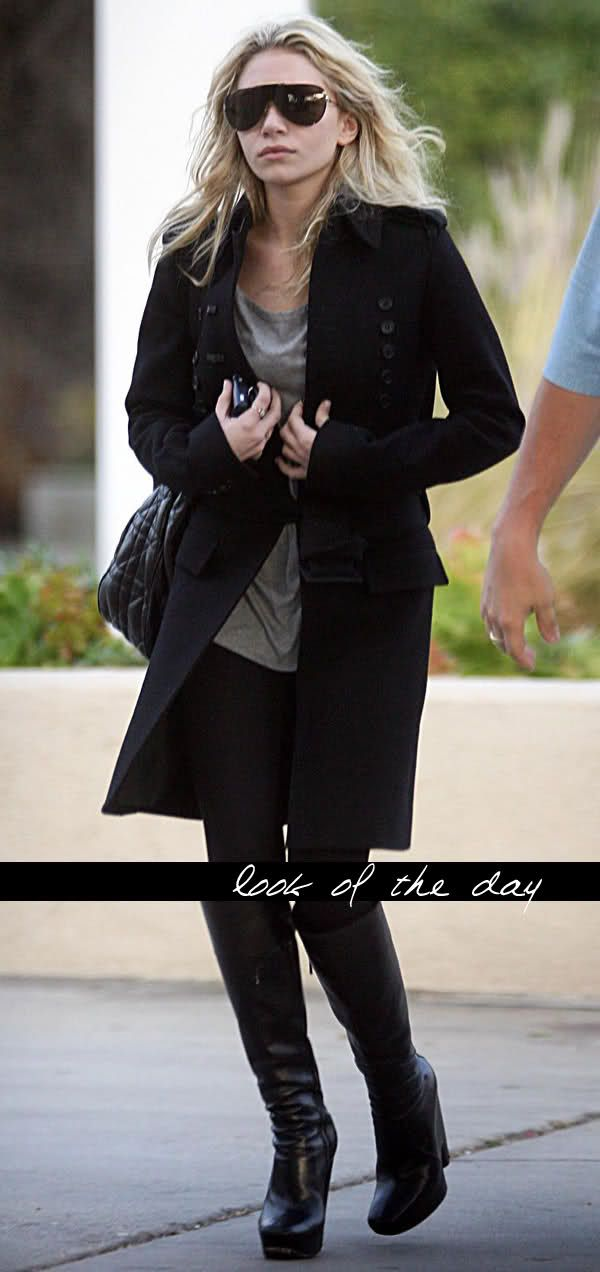 Ashley Olsen in oversized aviators, a long coat and knee high boots.