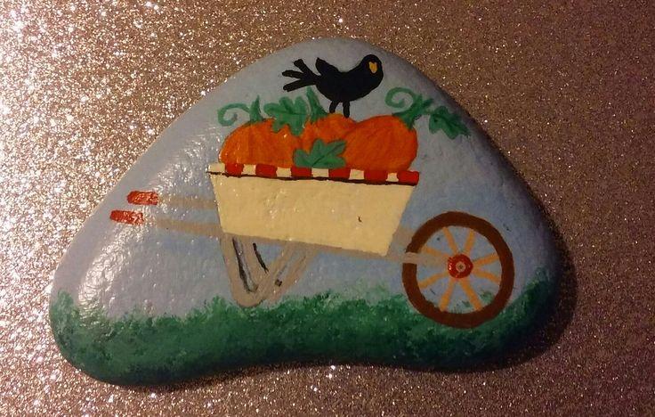 Pumpkins in a wheelbarrow painted on a Lake Huron beach stone by Cindy P 2017