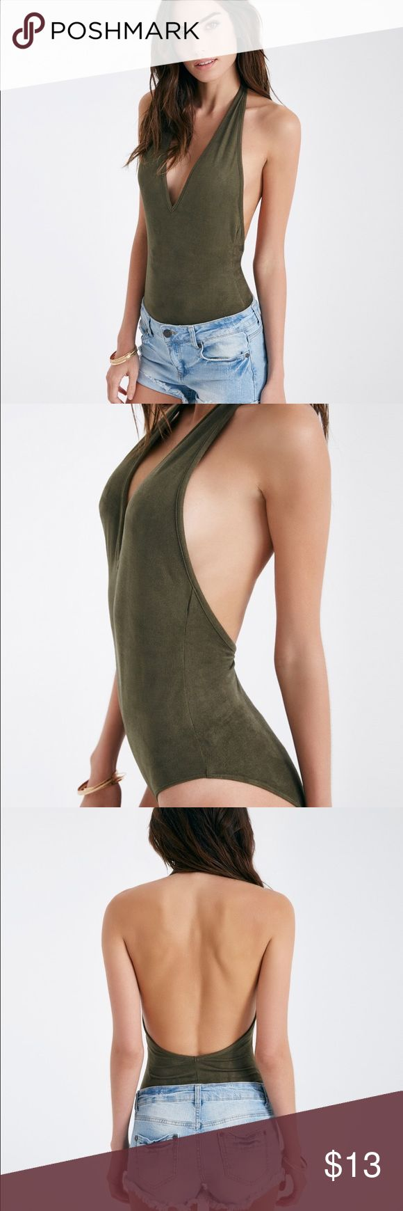 NEW SUEDE HALTER BODYSUIT Low Back M A bodysuit featuring a stretchy faux suede knit body, a halter neckline, and a low back. The bodysuit has a full coverage bottom.   V-Neckline 2-Snap Button Closure Halter Strap Unlined Polyester / Spandex Hand Wash Imported Wet Seal Intimates & Sleepwear Shapewear