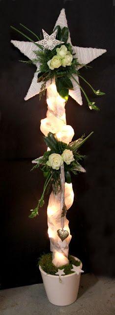 bloemstuk advent en kerst 2013 - standaard met sterren lampjes en bloemen