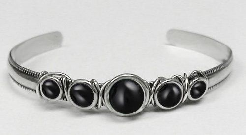 Sterling Silver Hand Made Cuff Accented with Genuine Black Onyx The Silver Dragon- Bracelets. $63.00. This Bracelet Fits a Standard Woman's Wrist. This Unique Bracelet is Created only after Your Order Arrives. Please Allow 7-10 days for Delivery.. Designed And Hand- Crafted in Sterling Silver. This Bracelet was Designed by The Silver Dragon, a Jewelry Shop in New England. Thank you for Supporting American Business.. The Silver Dragon uses Sterling Silver that has been Rec...