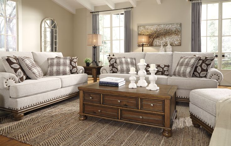 True Classic Character Comes To Life In The Harleson Living Room Set Set Back Pleated Rolled Arms And Warm Brown Expos Living Room Sets Furniture Living Decor