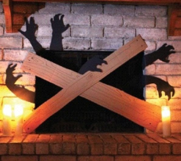 Best Halloween fireplace decor ever! #zombies @Crissy PoohNini you need to do this on your fireplace!