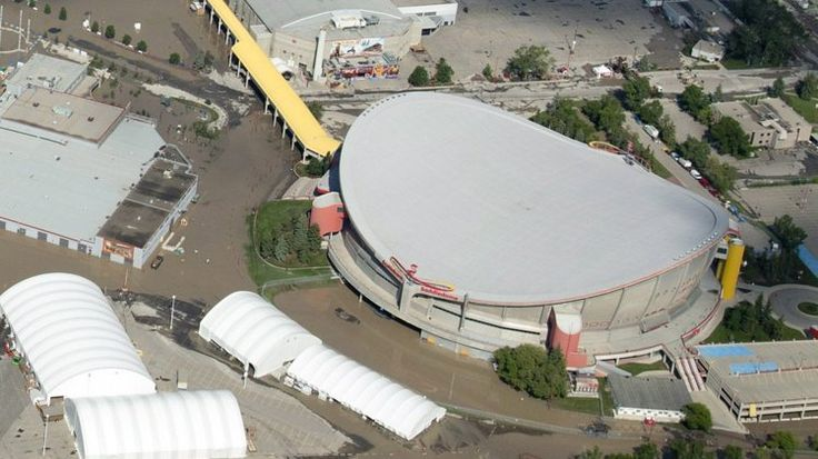 Calgary Saddledome Saturday, June 22, 2013 in Calgary, Alberta. The Saddledome, home to the National Hockey League's Calgary Flames, was flooded up to the 10th row. The two rivers that converge on the western Canadian city of Calgary. Ffloods devastated much of southern Alberta province, causing at least three deaths and forcing thousands to evacuate. (AP Photo/The Canadian Press, Jonathan Hayward)