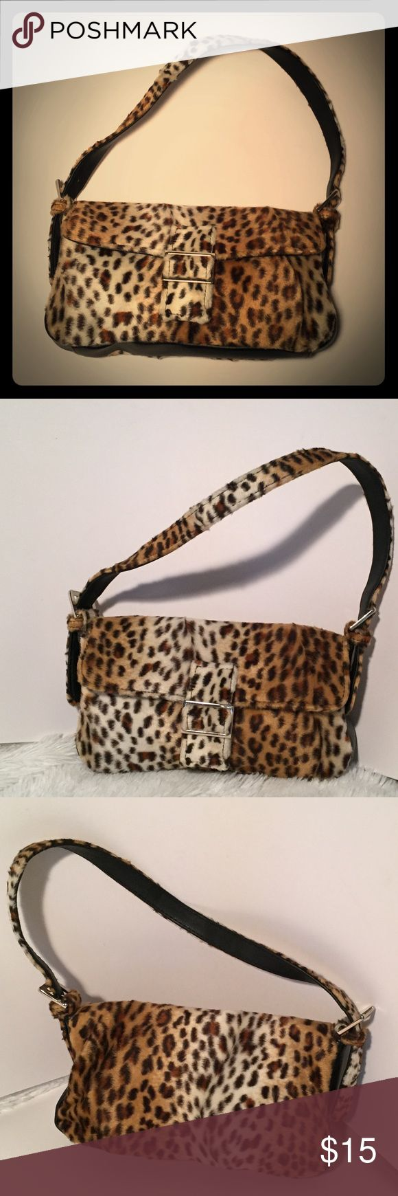 """Leopard Print Faux Fur Mini Handbag Super cute leopard print mini handbag with snap closure and adjustable straps on both sides. Soft and fuzzy. Perfect for a night out. Just add your small wallet, cell phone and lipstick and you're good to hit the town!  Approx measurements: Length 10"""" Width 2"""" Height 6""""  (061) Bags Mini Bags"""